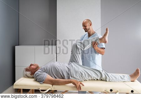 Doctor Doing Check And Physiotherapy Rehab After Injury