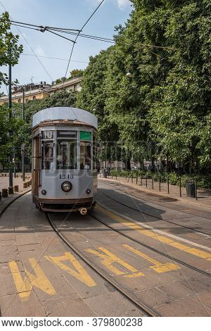 A Tram Travels In One Of The Streets Of An Italian City, Street Photography In Milan