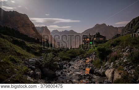 Nightscape In A Moutain Hut In The High Mountains With The Moon Present