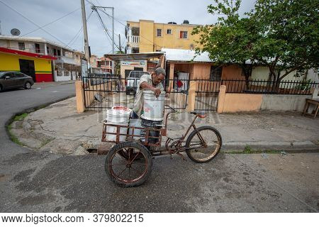 Santo Domingo / Dominican Republic - May 15 2018: Man With Tricycle With Trolley, Transporting Load