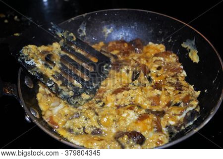 Cooking Mushrooms Onions Hash Browns And Cheese In A Frying Pan With Oil Seasoning And Dirty Spatula