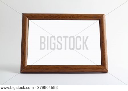 Empty Wooden Frame For Painting, Picture Or Text On White Wood Background. Wooden Blank Picture Fram