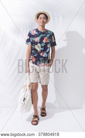 Full body Man casual wearing new stylish fruit printed T-shirts with white pants shorts with hat, holding handbag runway in studio in studio