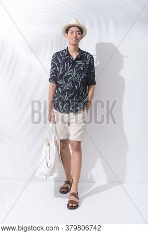 Full body Summer man casual wearing new stylish fern leaves printed long ,sleeves shirt with white pants and brown shoes runway in studio