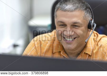 Online Working Concept. Smiley Man With Headset Having Online Conversation. Close Up Portrait.