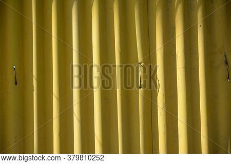 Metal Sheet Yellow Corrugated Barrier Use To Set Up A Perimeter Wall On Construction Site Or Vacant