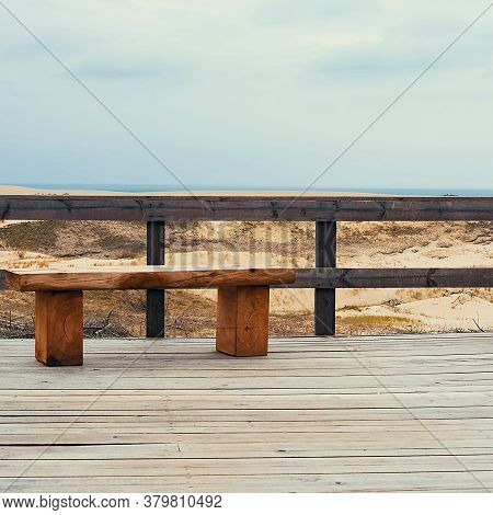 An Empty Bench Near The Sea. A Lone Bench On The Observation Deck.
