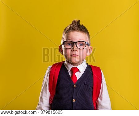 Back To School. Child In Uniform With Big Bag. Funny Schoolboy In Glasses Standing Read To Go To Sch