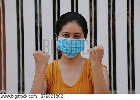 Masked Asian Woman Prevent Germs. Tiny Particle Or Virus Corona Or Covid 19 Protection. Lift The Fis
