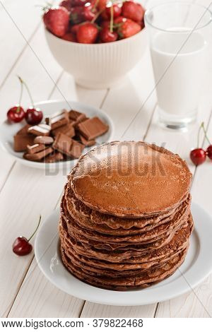 Brown Pancakes With Cherries, Chocolate And Milk