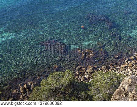 Clear Azure Waters Of The Mediterranean Sea Right On The Coast. Aerial View Of The Coast. Azure Sea