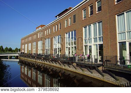 Almere Poort, The Netherland - June 22, 2020:  Dutch Row Houses On De Waterside In The City Of Almer