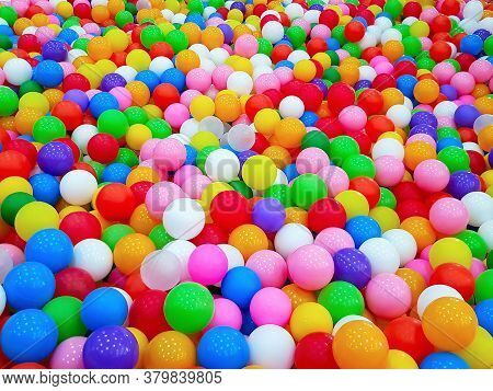 Background And Pattern Of The Colorful Plastic Balls On Children's Playground. Concept Of Kids Games
