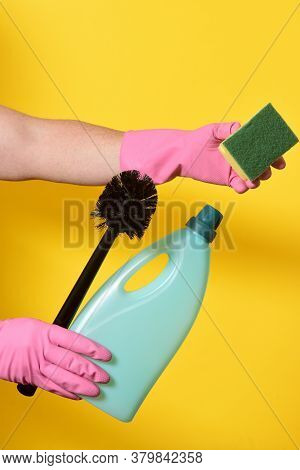 Set Of Cleaning Products On Yellow Background