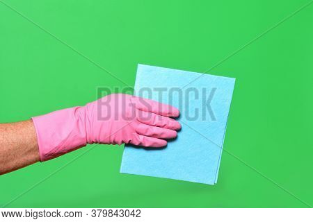 Hand With Baize On A Green Background