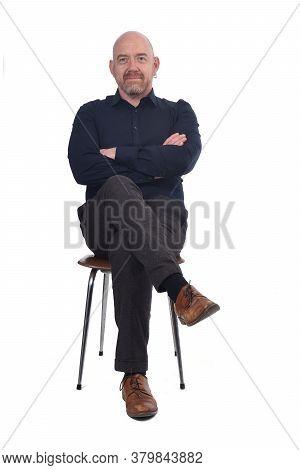 Bald Man Sitting On A White Background