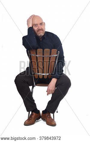 Bald Man Sitting On White Background, Worried