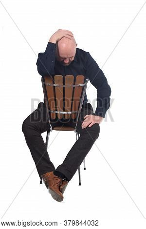 A Thoughtful Man Sitting On A Chair