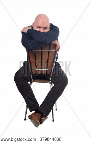 Bald Man Sitting On White Background, Cover His Face With His Arms