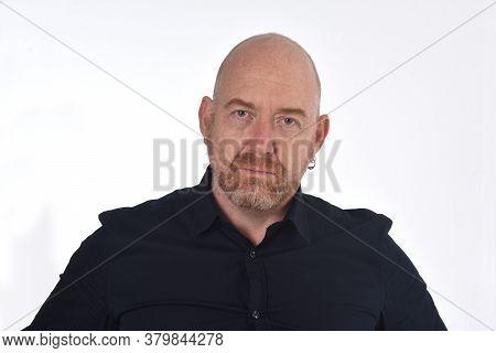 Portrait Of Bald Man On White, Serious