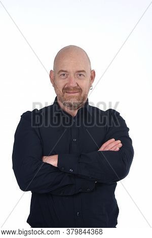 Portrait  Of Bald Man On White, Smiling And Arms Crossed