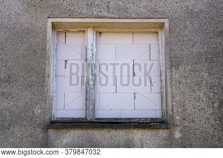 Bricked Up Window In A Dilapidated House