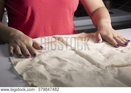 Girls Hands Prepare Pita Bread In A Gray Kitchen On A White Table Top. Cooking Process
