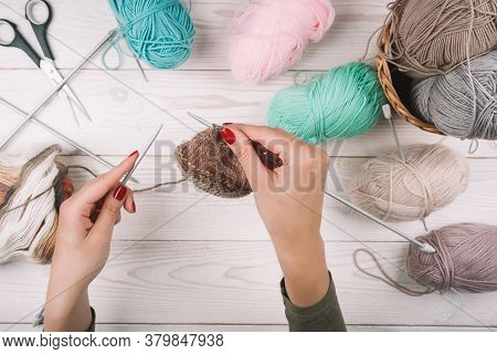 Knitting In Woman Hands. Close-up Of Hands Knitting. Colorful Threads. Selection Of Colorful Yarn Wo