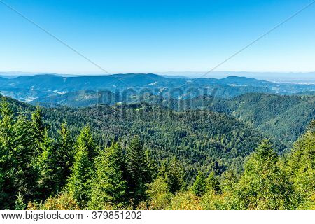 Scenic View Over Small Mountain Landscape With Conifer Forest In Summer