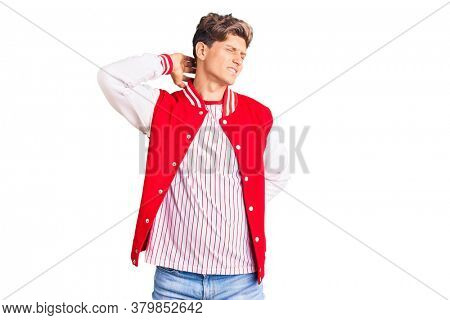Young handsome man wearing baseball uniform suffering of neck ache injury, touching neck with hand, muscular pain