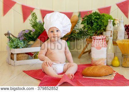 A Baby In A Cook's Hat Sits In A Beautiful Photo Zone With Flour And Vegetables, A Baby Cook, A Chil
