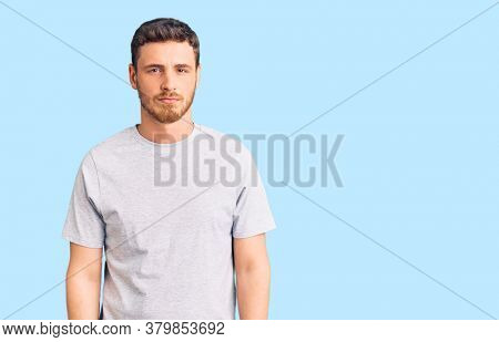 Handsome young man with bear wearing casual tshirt depressed and worry for distress, crying angry and afraid. sad expression.
