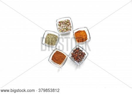 Top View Mix Indian Spices And Herbs Glass Pots On White Background With Copy Space For Design Veget