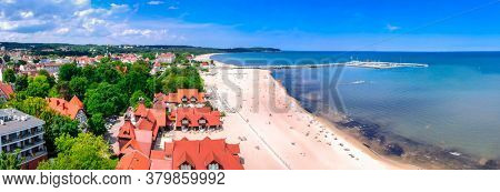 Panorama of the Baltic sea coastline with wooden pier in Sopot, Poland