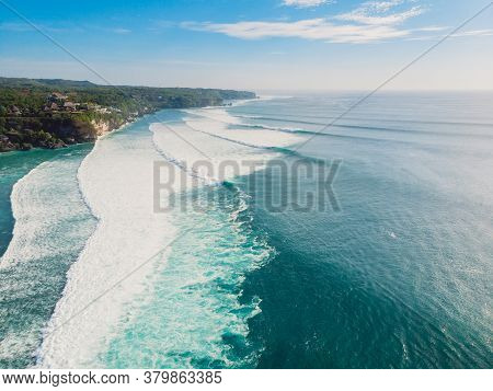 Surfing Waves In Ocean And Coastline Of Bali. Aerial View Of Surf Spot.