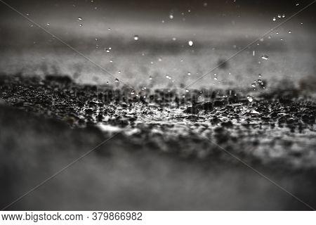 Rain Water Drops On Rain Water And Soil Field.
