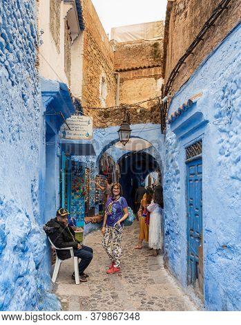 Chefchaouen, Morocco - October 26, 2018: View Of A Picturesque Street Of The Blue City With Tourists