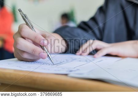 Woman Hands Student Testing In Exam On Exercise Taking At High School Or University In Test Room. Wr