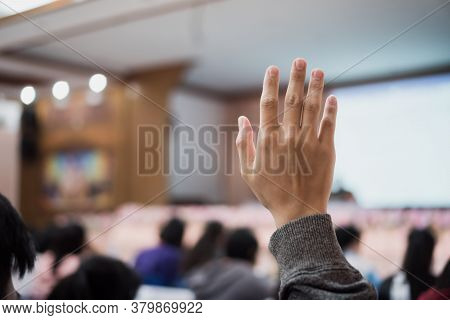 Audience Or Students Raising Hands Up At Conference To Answer Question While Speaker Speech At Semin