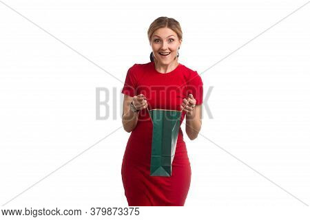 Blonde Girl With Short Hair On Isolat In A Red Dress And A Red Hat, With Colored Paper Shopping Bags
