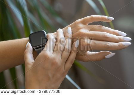 Close Up Photo Of A Female Hands With Smartwatch.