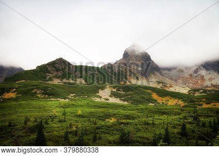 Tatra Mountains Peaks On A Foggy Day.