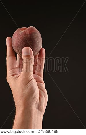 Peach On Outstretched Arm. On Isolated Background
