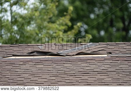 Roof Shingles Have Been Damaged By Heavy Winds And Strong Storms