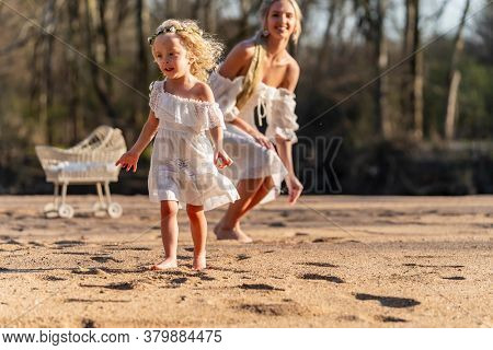 A beautiful young mother and her daughter enjoy the spring weather