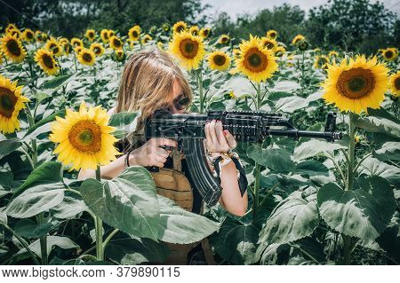 Beautiful And Attractive Woman Soldier With Rifle Machine Gun. Front View Gun Point. Female  Army Na