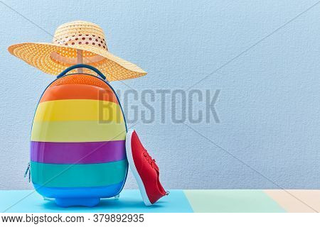 Time To Travel. Summer Vacation. Travelling Abroad. Colourful Suitcase, Shoes And Female Straw Hat,