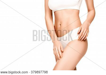View Of Young Woman In Panties And Top Standing Isolated On White