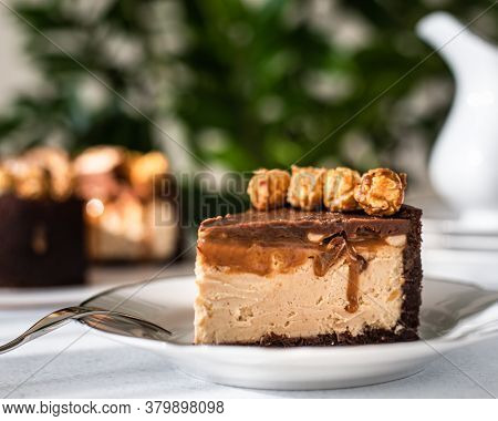Cheesecake With Nuts And Caramel. Cheesecake Snickers. Caramel Cake. Slice Of Caramel Cheesecake Wit