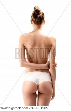 View Of Woman In Panties Standing With Arms Behind Back Isolated On White